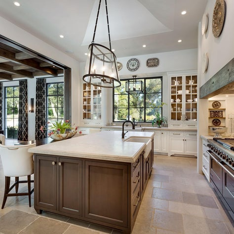 Spanish Colonial Equestrian Estate, kitchen island, limestone and decorative tile backsplash