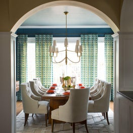 Transitional dining room with arched doorway