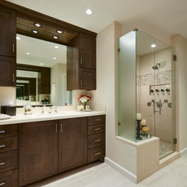 Neutral guest bathroom on the first floor with warm wood cabinetry.