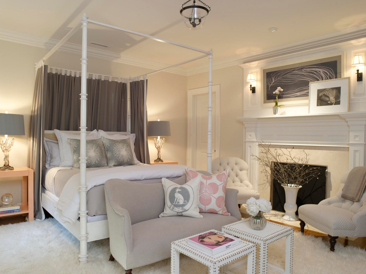 White and Grey Guest Bedroom with Canopy Bed and Fireplace