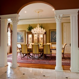 Corinthian columns & pilasters support the crown molding gracing the dining room