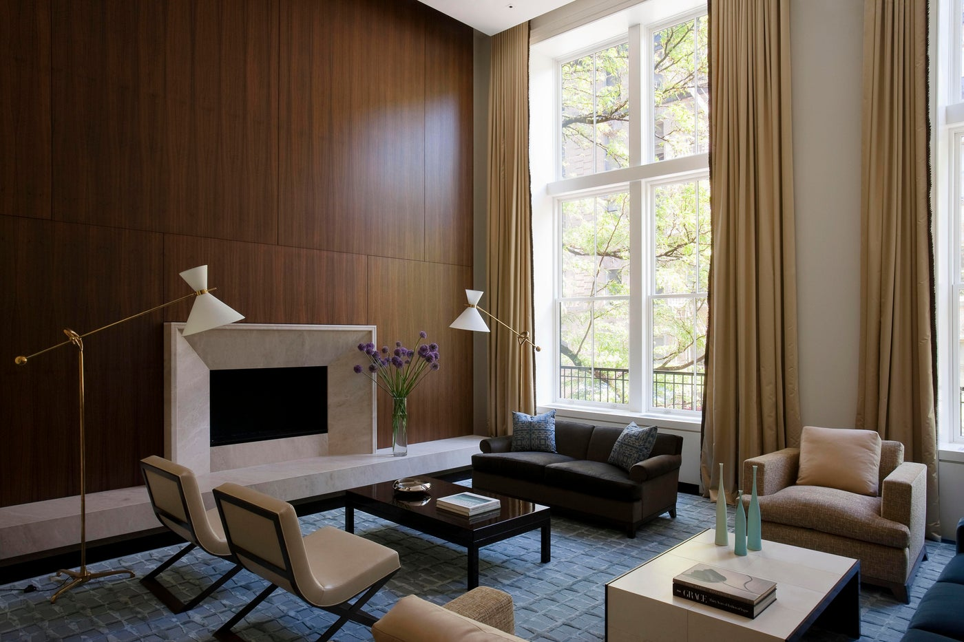 NYC Modern Townhouse Living Room with vintage lamps, and walnut paneling.