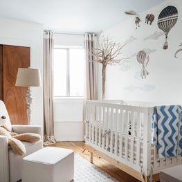 Hand-painted mural in the nursery lets imaginations young and grown take flight.