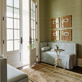 Southern Foyer with french doors, shiplap walls, custom banquettes & oushak rug