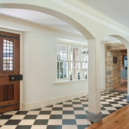 Farmhouse Foyer with checkered tile floors and arched doorways in Malvern, PA