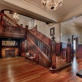 Clocktower Farm, Restored Entry Hall and Stair with Fireplace and Chandeliers