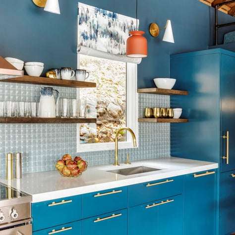 BLUE CABINETS WOOD CEILING, PILLOWED TILE, BRASS ACCENTS RECLAIMED OPEN SHELVING