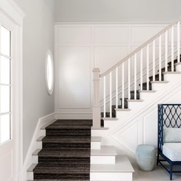 A custom staircase crafted by an Amish manufacturing company.