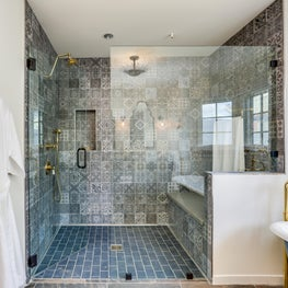 Open Shower area in private villas with porcelain tiles and brass fixtures