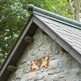 Metal Cap on Reclaimed Dogeared Slate Roof