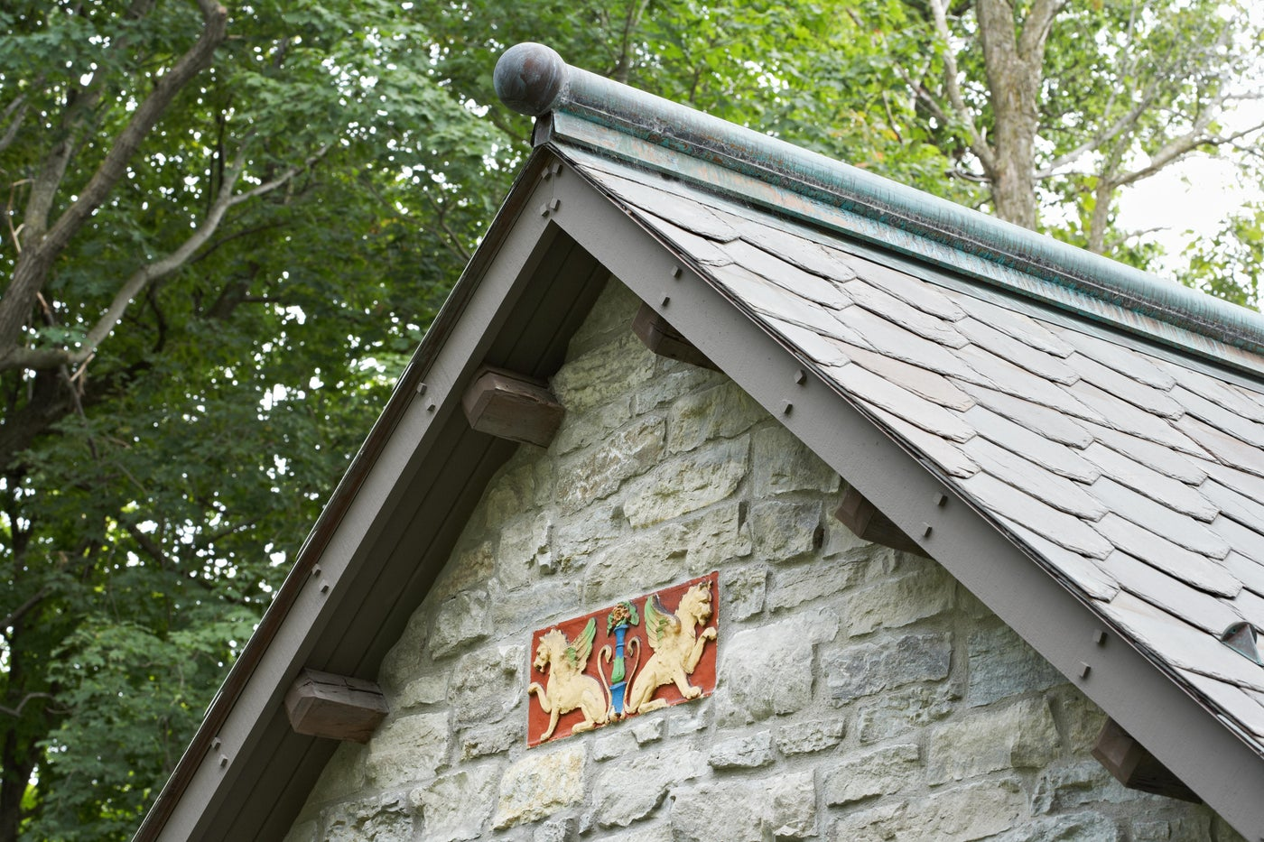 Metal Cap on Reclaimed Dogeared Slate Roof
