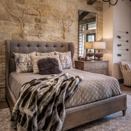 Multiple textures and patterns add visual interest to this monochromatic bedroom