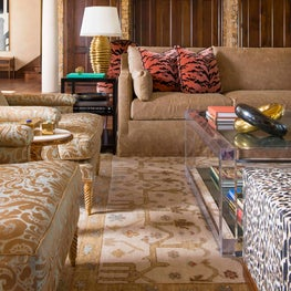 Modern gold accessories and details add richness to this room