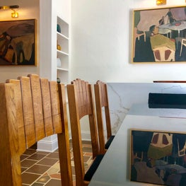 Vintage art deco dining chairs and statement lighting and original artwork
