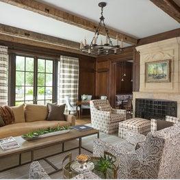 Rustic modern sitting room with wood beam ceilings