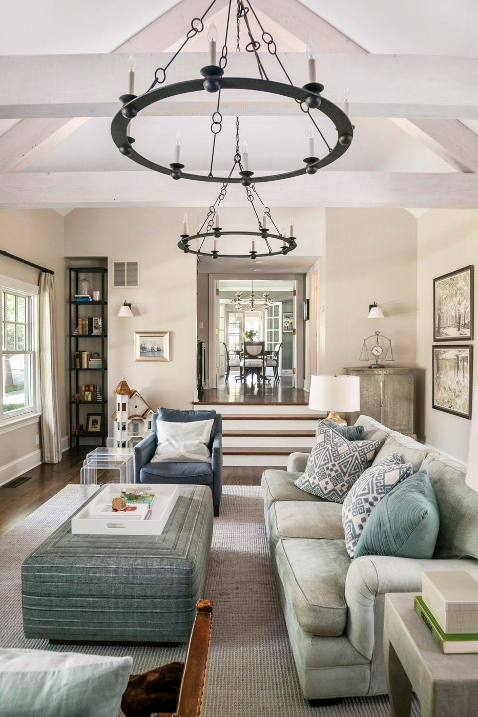 North End Boise family room exposed beams, pair chandeliers & green sofa