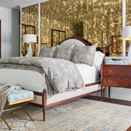 Master Bedroom Featuring Antique Mirror Wall