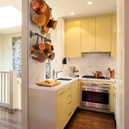 Warm kitchen with yellow cabinetry