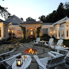 A stone-surround fire pit creates a backdrop for entertaining.