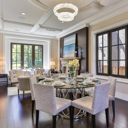 Sophisticated, comfortable dining room with coffered ceiling