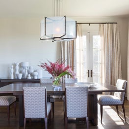 This sun drenched contemporary Dining Room with its walnut dining table and modern dining chairs upholstered in a light gray patterned fabric invite you to sit back and enjoy a farm-to-table meal - Los Altos Hills Residence