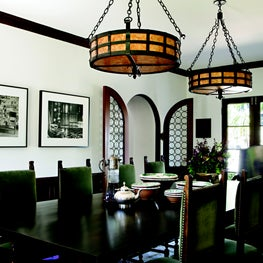 Dining room with wooden wainscoting and rondel leaded glass-paned doors