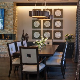 Dining Room with lowered ceiling detail, grid art and metal suspended pendants
