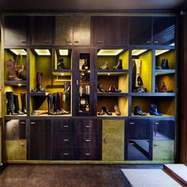 Custom Cabinetry, Internally Olive Velvet Lined, externally Leather Wrapped for a Fashion Boutique