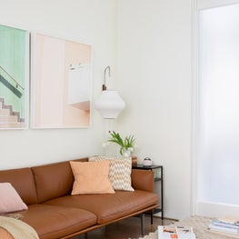 Cheerful Modern San Francisco Condo Family Room with Pastel Art and Leather Sofa