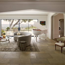 Living room with a view and french limestone floors.