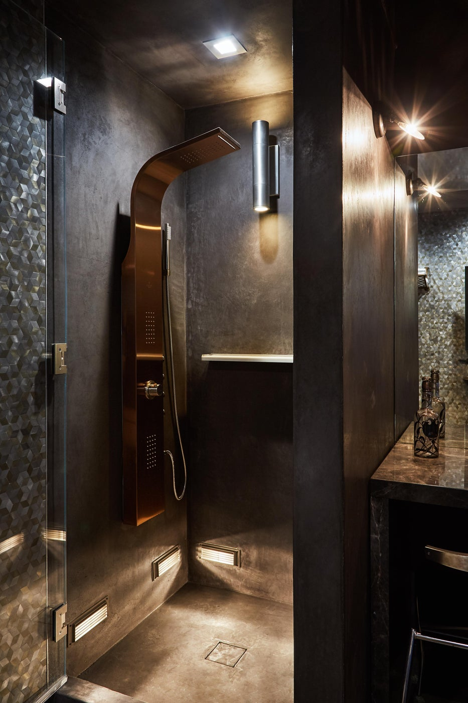 Plastered shower walls, marble vanity, & curved rainhead shower spa system