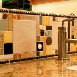 NW hills, Portland, OR:   Eclectic Tile backsplash detail in guest bathroom.