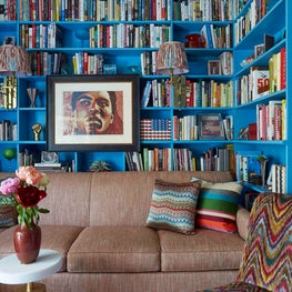 Colorful Library with custom upholstery and blue built-ins