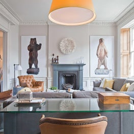 Bear with me! / The fireplace of this parlor is flanked by real life sized photos and peppered with a collection of lovely antiques. An overscaled yellow lampshade brings a pop of joy and brightness throughout the seasons.