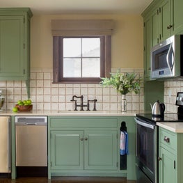 Contemporary farmhouse with green painted cabinets, rustic touches