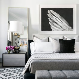 Black and White Graphic Bedroom Space with Custom Linens and Contemporary Art