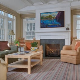 "Color,texture and art work make this reonovated family room ""read""happy and warm"
