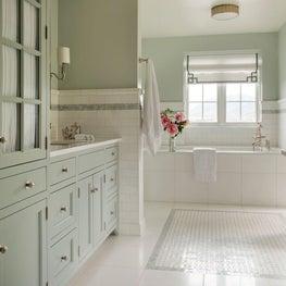 Sleek green and white modern farmhouse master bath