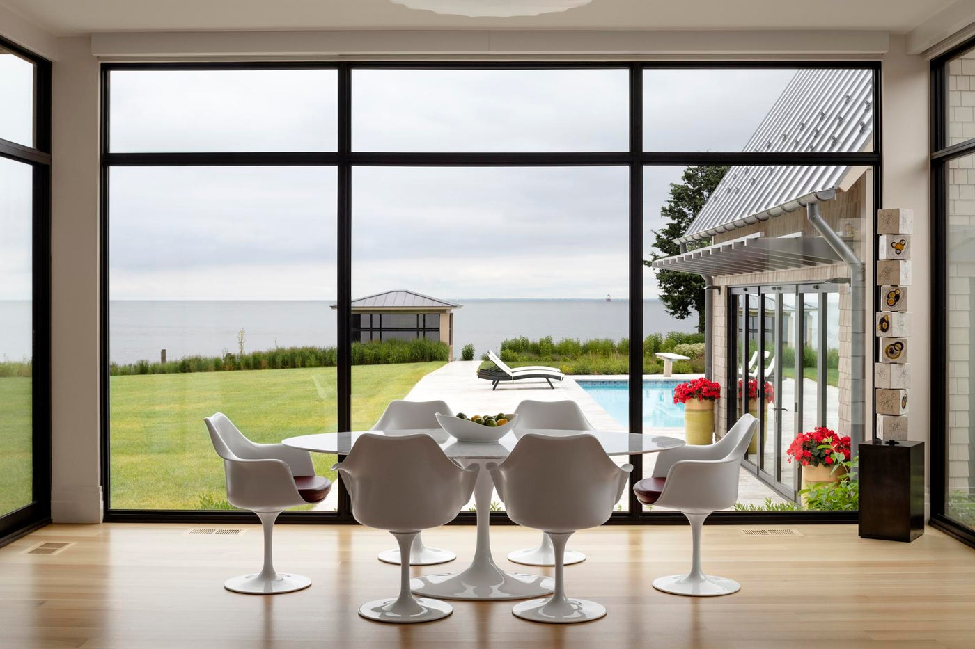 Waterfront House, a breakfast room with three glass walls