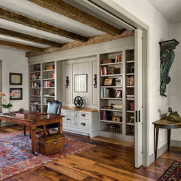 Antique timbers and salvaged oak flooring distinguish this study.