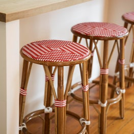 Interior kitchen with woven red and beige barstools