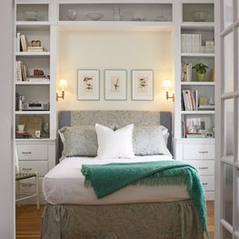 Classic blue and white bedroom with custom built-ins provide optimal storage