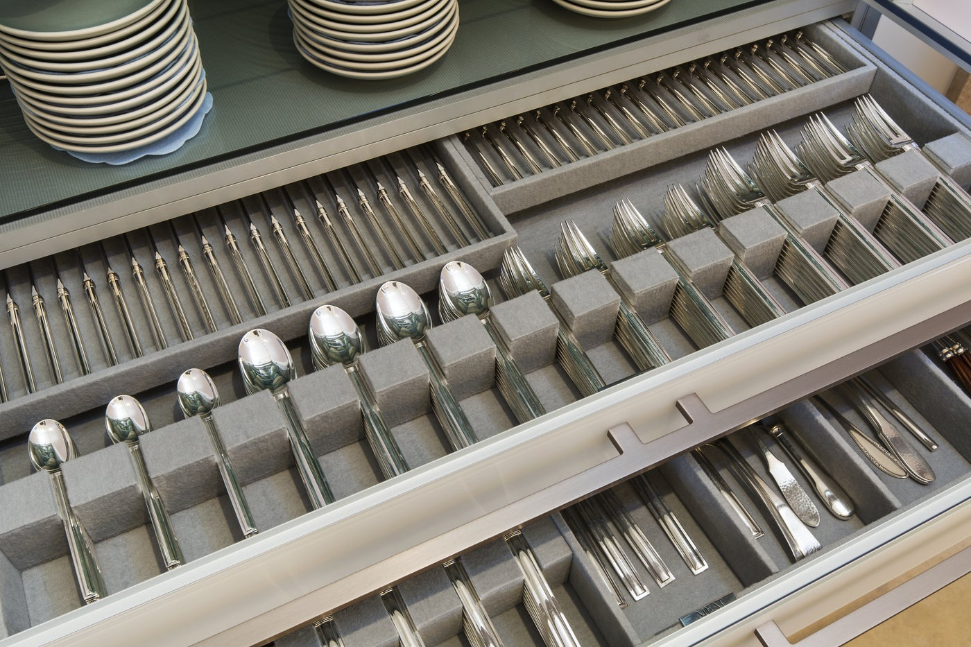 Sterling silver layered in drawers lined in chic fabrics.