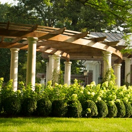 The lower curved pergola sections create intimate spaces.