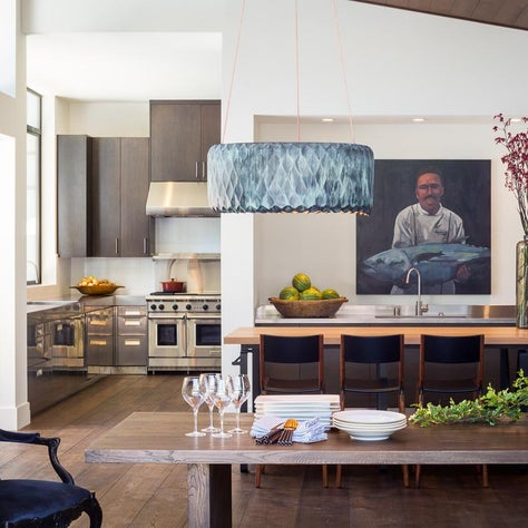 Modern, eclectic kitchen and dining space.