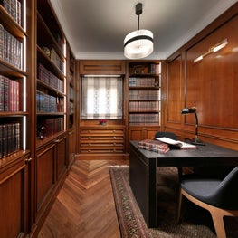 Bespoke home library in rich walnut wood.