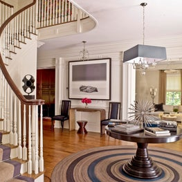 Modern Blue and Taupe Entry with Round Table and Rug
