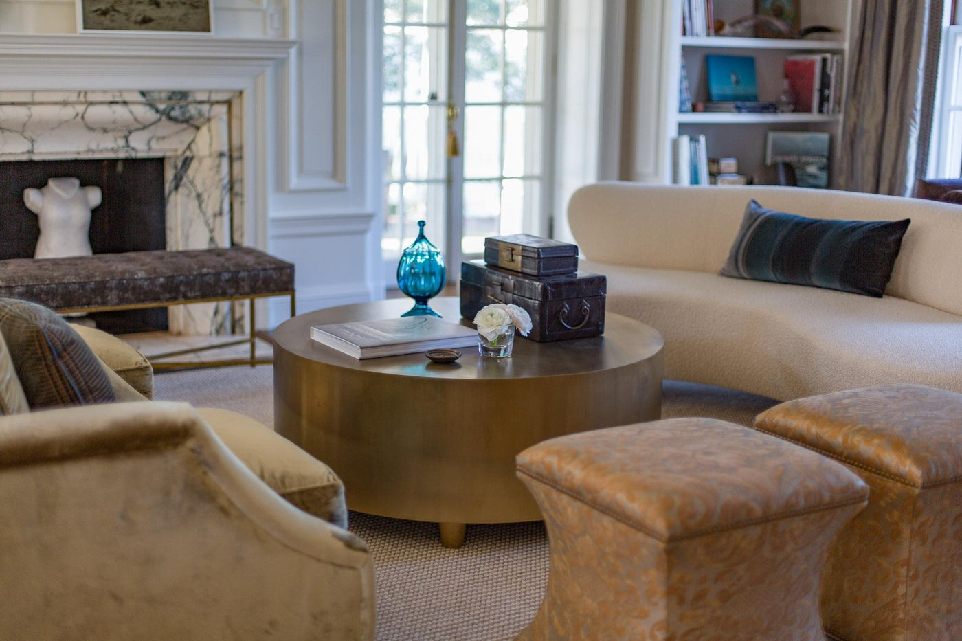 Living Room with Vladimir Kagan Sofa, Fortuny Stools and Round Brass Coffee Table