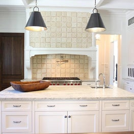 White and gray kitchen with custom tiled hood.