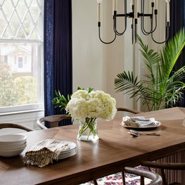 Ridgedale, A Modern Dining Room with Navy Blue Drapery and An Antique Rug